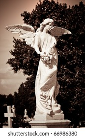 Angel in a cemetery in sepia tones