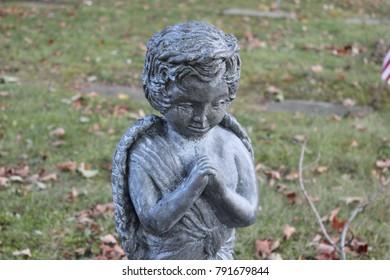 Angel cherub marble stone memorial statue in old cemetery