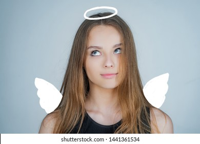 Angel. Child with angelic character. Lovely and cute youth. Girl angel with halo in white angel dress. Valentines day cupid