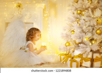 Angel Child and Christmas Tree with Presents Gifts, Kid Girl Costume holding Candle Light