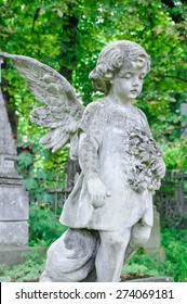 Angel child statue in the cemetery