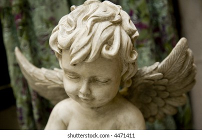 Angel. Closeup of marble sculpture. Contemplating angel.
