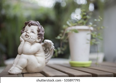 Angel or cupid figure with the green background