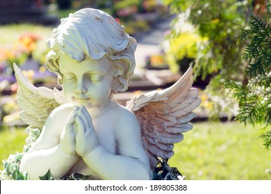 Angel figure in a cemetery / Cemetery