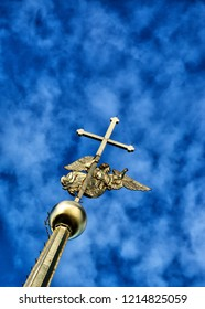 angel figure and cross on the spire of Peter and Paul Cathedral