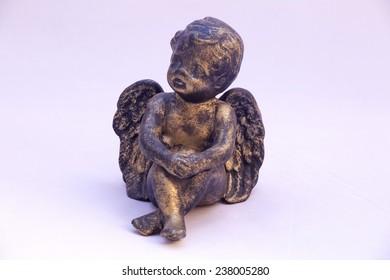 Angel figurine on white background.