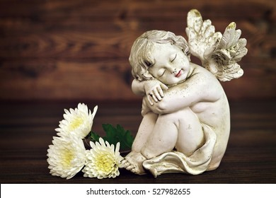 Angel figurine and white flowers