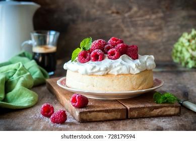 Angel food cake with whipped cream and fresh raspberries