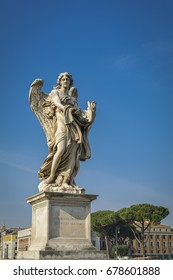 Angel with the Garment and Dice on Ponte Sant'Angelo (Bridge of Hadrian) in front of Castel Sant'Angelo (Castle of the Holy Angel)  in Parco Adriano, Rome, Italy