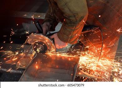 Angel grinder make a flash sparks metal cutting