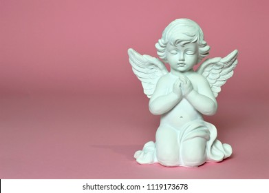 Angel guardian praying