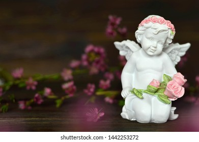 Angel holding bunch of roses
