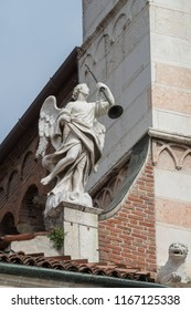 Angel holding a trumpet on the facade of Cremona Cathedral, Lombardy region, Italy