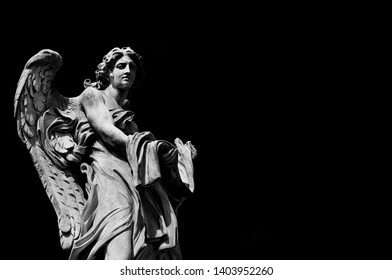 Angel marble statue with garment and dice, a 17th century baroque masterpiece on Holy Angel Bridge in Rome (Black and White with copy space)