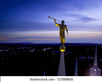 Angel Morosi statue atop playing a song to the rising crescent moon from atop the Mormon Temple in Portland, Oregon.