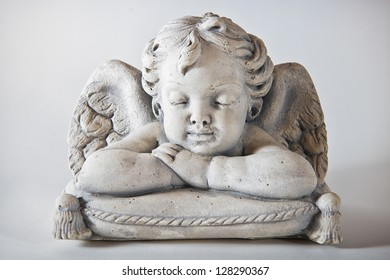Angel on upholstery with light background