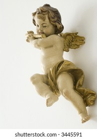angel playing a trumpet over white background
