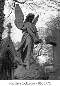 Angel sculpture in Pere Lachaise parisian cemetery