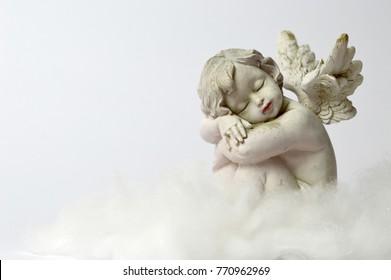 Angel sleeping on the cloud