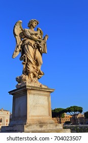 angel statue of the Ancient bridge in front of Castel Sant Angelo, Rome - Italy