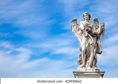 Angel statue by Bernini along Sant'Angelo bridge in Rome, Italy. Rome statues were sculptured by great artists especially during baroque era