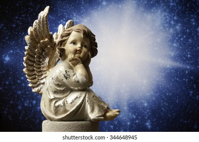 angel statue with divine light