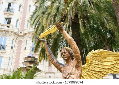 The angel statue with golden palm in Cannes, France, Cote d'Azur.