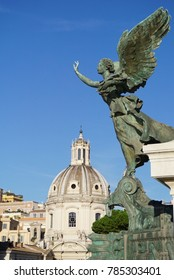 Angel Statue at the Monumento Nazionale a Vittorio Emanuele II overlooking the Santissimo Nome de Maria al Foro Traiano Church or The Church of the most Holy Name of Mary at the Trajan Forum