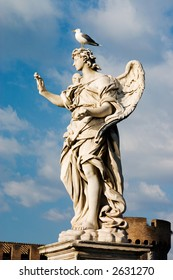Angel statue on Ponte del Angelo Rome with a Sea Gull on the Head
