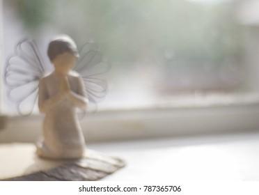 angel statue outufocus pray . Religion background
