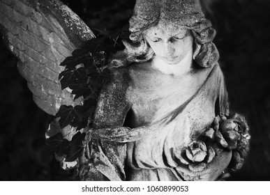 Angel in the sunlight.  Fragment of ancient statue. Retro styled.