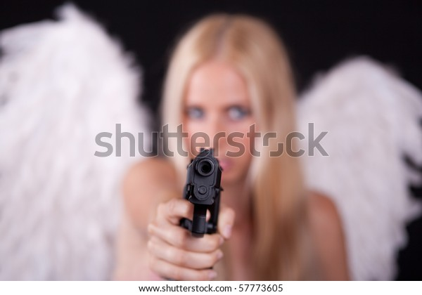 Angel with white wings, aiming weapon in his arm.  Black background.