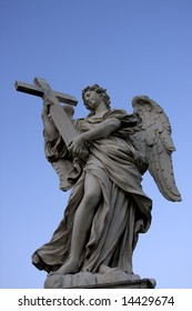 Angel with wings in Rome over blue sky