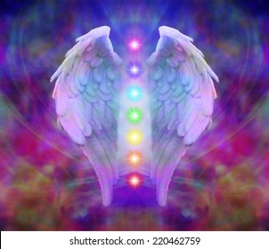 Angel wings and seven chakras on colorful background
