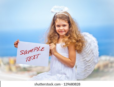 Angel-girl holds paper with your text