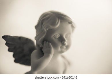 Angelic cupid statue - monochrome picture style