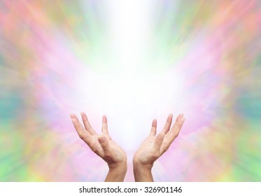 Angelic Energy Healer - Female energy worker with hands outstretched and open upwards sensing healing energy on ethereal rainbow colored  energy formation background