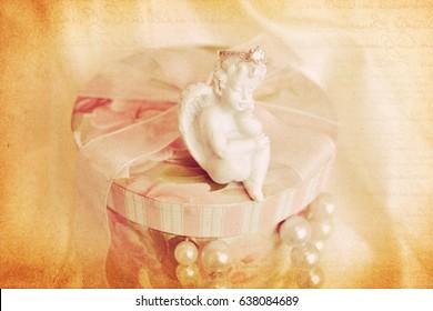 Angelic figurine. Vintage background