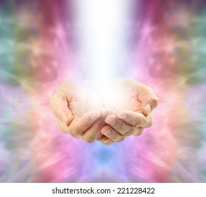 Angelic Healing Energy   -  Female spiritual healer's cupped hands with misty bright energy emerging from pastel colored energy background