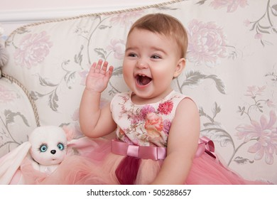 Angelic Little child Girl in a beautiful pink Dress. Childhood. Baby Girl in a beautiful Dress. Cute princess in beautiful dress