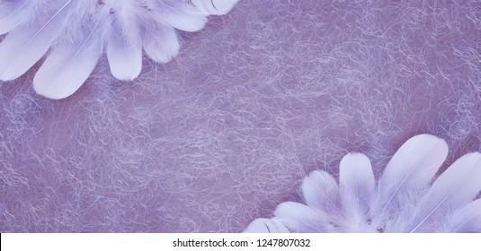 Angelic Pink White Feather Double Corner Dusky Pink Background  - a random pile of long thin white feathers placed in opposite corners against a rustic swirly hand made pink lilac paper background
