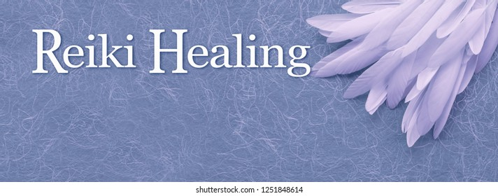 Angelic Reiki Healing Banner Head - a neat pile of long thin white feather in the right corner beside the words REIKI HEALING on a fibrous blue handmade  paper background with copy space