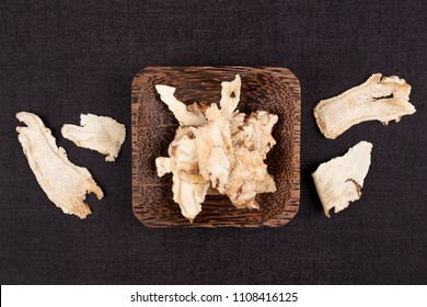 Angelica root used in chinese traditional herbal medicine over black background. Radix angelicae sinensis, Dang gui.