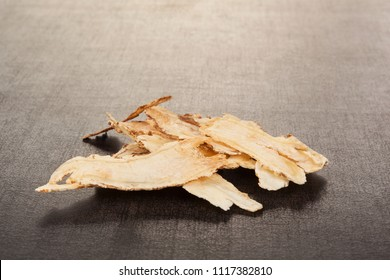 Angelica root used in chinese traditional herbal medicine over black background. TCM.