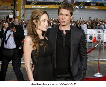 """Angelina Jolie and Brad Pitt attend the Los Angeles Premiere of """"Ocean's Thirteen"""" held at the Grauman's Chinese Theatre in Hollywood, California, on June 5, 2006."""