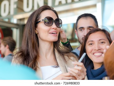 Angelina Jolie on the autograph session after Women in the World Canada Summit during the 2017 Toronto International Film Festival - September 11, 2017 in Toronto, Canada