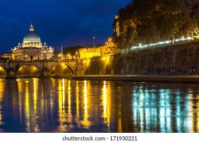 Angelo Bridge and St. Peter's Basilica at dusk, Rome, Italy