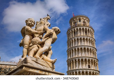 Angels and the famous Leaning tower in Pisa, Italia.