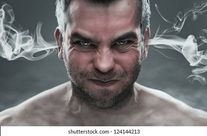 Anger, close up of angry man with smoke coming out from his ears