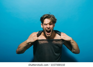 Anger concept. Aggressive man shout with anger. Guy tear tshirt with anger. Anger attack. I am so angry.